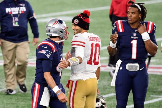 Oct 25, 2020; Foxborough, Massachusetts, USA; San Francisco 49ers quarterback Jimmy Garoppolo (10) high-fives New England Patriots quarterback Jarrett Stidham (4) in front of quarterback Cam Newton (1) after a game at Gillette Stadium. Mandatory Credit: Brian Fluharty-USA TODAY Sports