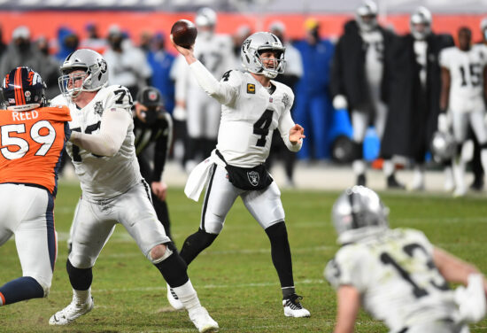 Jan 3, 2021; Denver, Colorado, USA; Las Vegas Raiders quarterback Derek Carr (4) throws a two point conversion pass in the fourth quarter against the Denver Broncos at Empower Field at Mile High. Mandatory Credit: Ron Chenoy-USA TODAY Sports