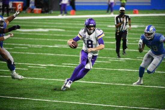 Jan 3, 2021; Detroit, Michigan, USA; Minnesota Vikings quarterback Kirk Cousins (8) runs the ball during the third quarter against the Detroit Lions at Ford Field. Mandatory Credit: Tim Fuller-USA TODAY Sports