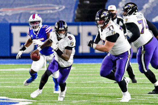 Jan 16, 2021; Orchard Park, New York, USA; Baltimore Ravens quarterback Lamar Jackson (8) runs with the ball against the Baltimore Ravens during the second half of an AFC Divisional Round playoff game at Bills Stadium. Mandatory Credit: Mark Konezny-USA TODAY Sports