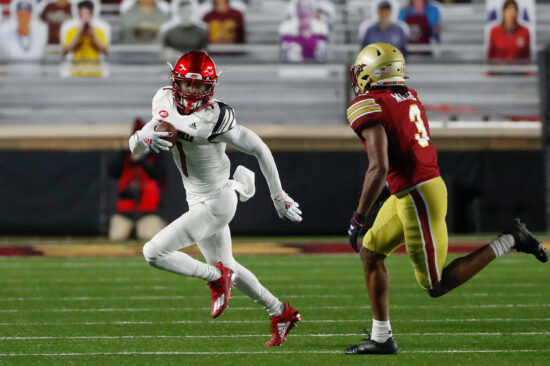 Nov 28, 2020; Chestnut Hill, Massachusetts, USA; Louisville Cardinals wide receiver Tutu Atwell (1) runs against the Boston College Eagles during the second half at Alumni Stadium. Mandatory Credit: Winslow Townson-USA TODAY Sports