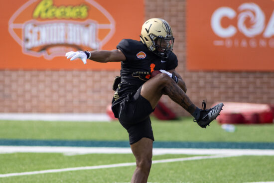 Jan 26, 2021; Mobile, Alabama, USA; National wide receiver D'Wayne Eskridge of Western Michigan (1) grabs a pass during National team practice during the 2021 Senior Bowl week. Mandatory Credit: Vasha Hunt-USA TODAY Sports