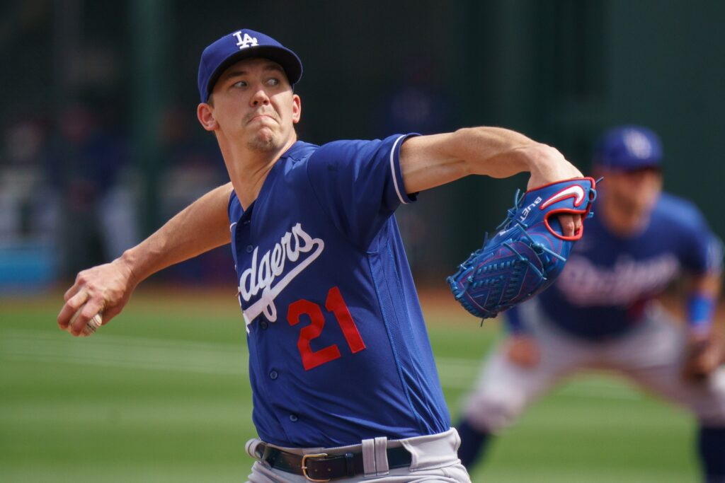 Mar 7, 2021; Surprise, Arizona, USA;  Los Angeles Dodger pitcher Walker Buehler (21) pitches in the first inning  against the Texas Rangers at Surprise Stadium. Mandatory Credit: Allan Henry-USA TODAY Sports