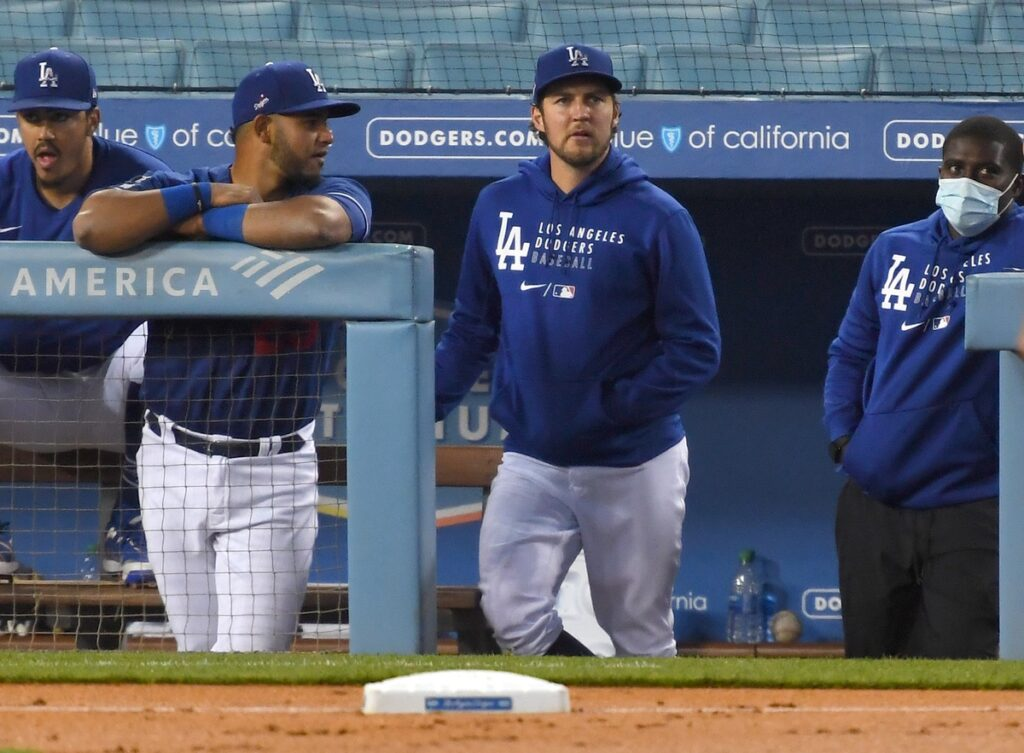 Mar 29, 2021; Los Angeles, California, USA;  Los Angeles Dodgers starting pitcher Trevor Bauer (27) looks on from the dugout during a game against the Los Angeles Angels at Dodger Stadium. Mandatory Credit: Jayne Kamin-Oncea-USA TODAY Sports