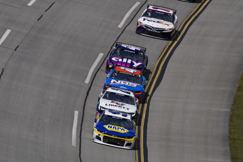 Apr 25, 2021; Talladega, Alabama, USA; NASCAR Cup Series driver Chase Elliott (9) leads a pack during the GEICO 500 at Talladega Superspeedway. Mandatory Credit: Marvin Gentry-USA TODAY Sports