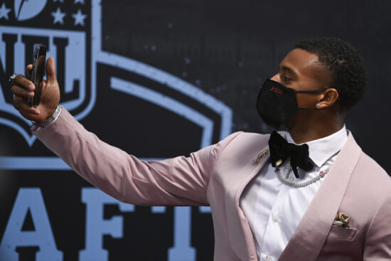 Apr 29, 2021; Cleveland, OH, USA; Alabama cornerback Patrick Surtain II holds up his phone as he appears on the Red Carpet  at the Rock & Roll Hall of Fame before the first round of the 2021 NFL football draft, Thursday, April 29, 2021, in Cleveland.  Mandatory Credit: David Dermer/Pool Photo-USA TODAY Sports
