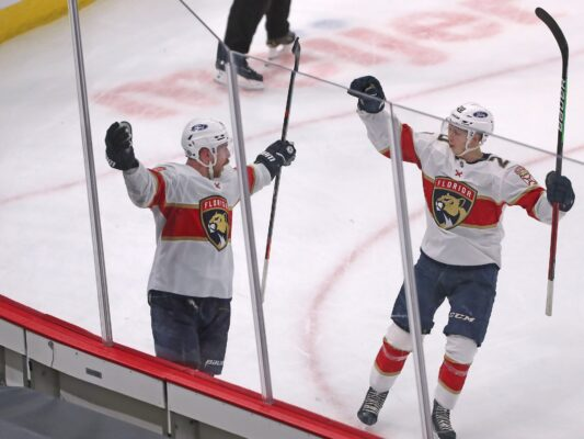 Apr 29, 2021; Chicago, Illinois, USA; Florida Panthers center Sam Bennett (9) celebrates scoring the game winning goal with center Aleksi Heponiemi (20) during overtime against the Chicago Blackhawks at the United Center. Mandatory Credit: Dennis Wierzbicki-USA TODAY Sports