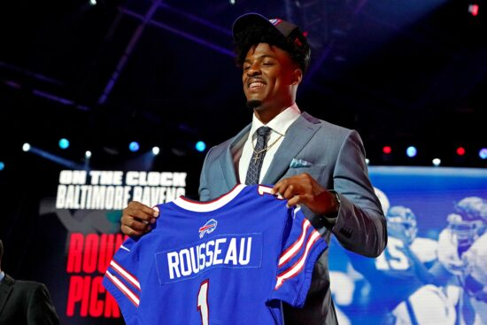 Apr 29, 2021; Cleveland, Ohio, USA; Gregory Rousseau (Miami) poses with a jersey after being selected by the Buffalo Bills as the number 30 overall pick in the first round of the 2021 NFL Draft at First Energy Stadium. Mandatory Credit: Kirby Lee-USA TODAY Sports