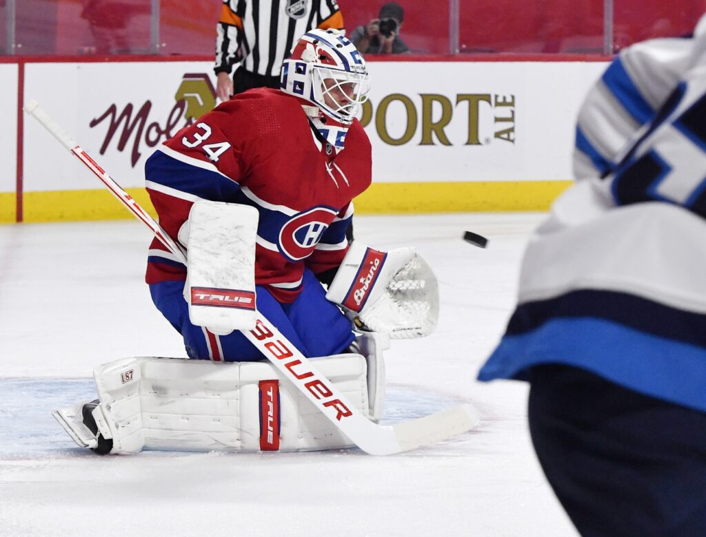 Apr 30, 2021; Montreal, Quebec, CAN; Montreal Canadiens goalie Jake Allen (34) makes a save during the first period of the game against the Winnipeg Jets at the Bell Centre. Mandatory Credit: Eric Bolte-USA TODAY Sports