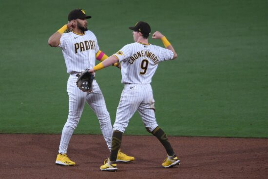 Apr 30, 2021; San Diego, California, USA; San Diego Padres shortstop Fernando Tatis Jr. (L) and second baseman Jake Cronenworth (9) celebrate on the field after defeating the San Francisco Giants at Petco Park