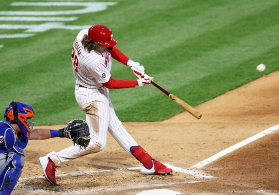 May 1, 2021; Philadelphia, Pennsylvania, USA;  Philadelphia Phillies third baseman Alec Bohm (28) hits a two-run home run against the New York Mets in the sixth inning at Citizens Bank Park. Mandatory Credit: Kam Nedd-USA TODAY Sports