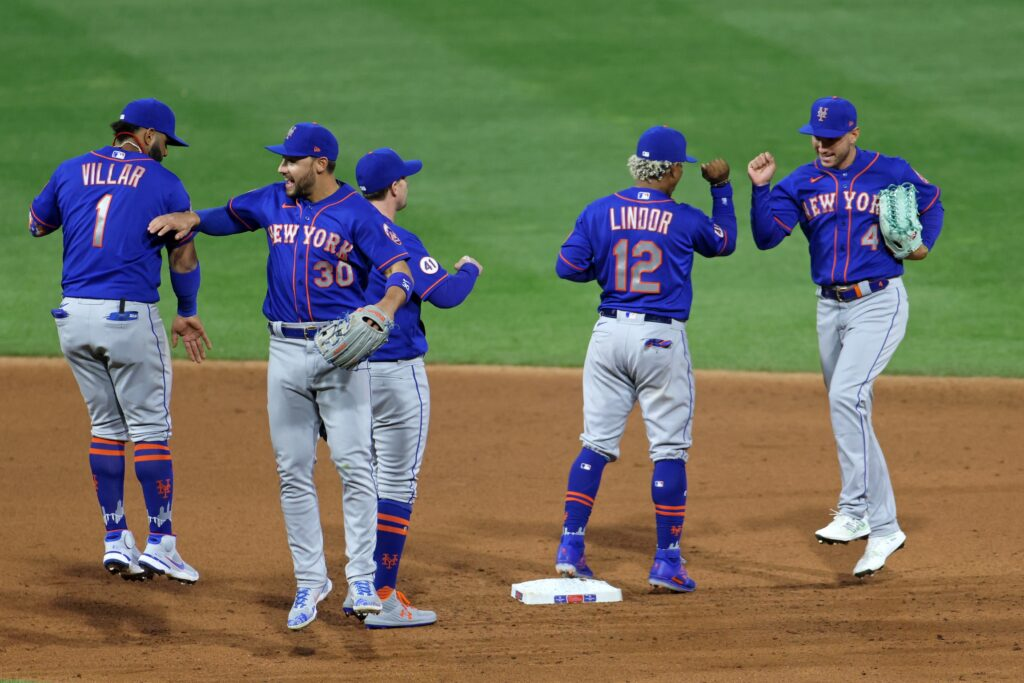 May 1, 2021; Philadelphia, Pennsylvania, USA;  New York Mets right fielder Michael Conforto (30) and shortstop Francisco Lindor (12) celebrate victory with teammates over the Philadelphia Phillies at Citizens Bank Park. Mandatory Credit: Kam Nedd-USA TODAY Sports