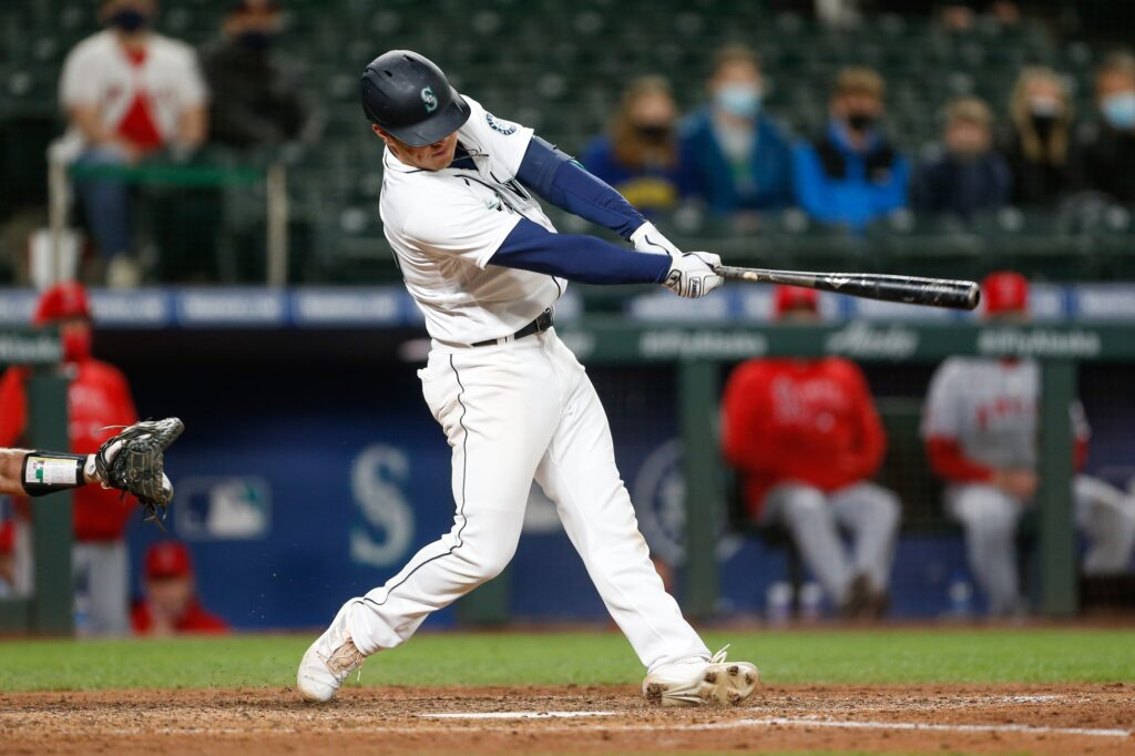 May 1, 2021; Seattle, Washington, USA; Seattle Mariners second baseman Dylan Moore (25) hits a two-run single against the Los Angeles Angels during the eighth inning at T-Mobile Park. Mandatory Credit: Jennifer Buchanan-USA TODAY Sports