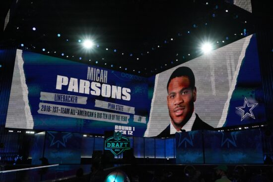 Apr 29, 2021; Cleveland, Ohio, USA; Penn State Nittany Lions wide receiver Micah Parsons is displayed on the video board after being selected as the 12th  pick by the Dallas Cowboys during the 2021 NFL Draft  at First Energy Stadium. Mandatory Credit: Kirby Lee-USA TODAY Sports