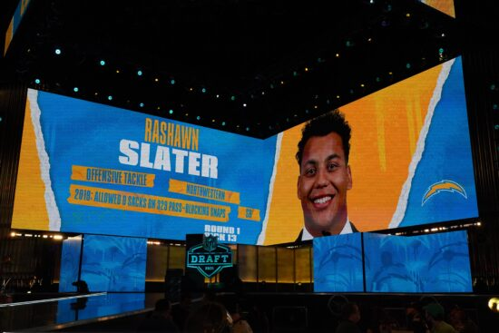 Apr 29, 2021; Cleveland, Ohio, USA; Northwestern Wildcats offensive lineman Rashawn Slater is displayed on the video board after being selected as the 13th  pick by the Los Angeles Chargers during the 2021 NFL Draft  at First Energy Stadium. Mandatory Credit: Kirby Lee-USA TODAY Sports