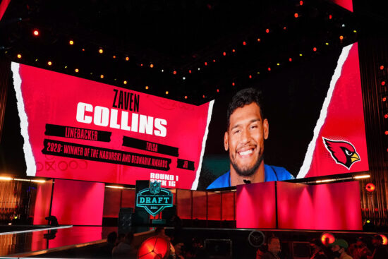 Apr 29, 2021; Cleveland, Ohio, USA; Tulsa Golden Hurricane linebacker Zaven Collins  is displayed on the video board after being selected as the 16th pick by the Arizona Cardinals during the 2021 NFL Draft  at First Energy Stadium. Mandatory Credit: Kirby Lee-USA TODAY Sports