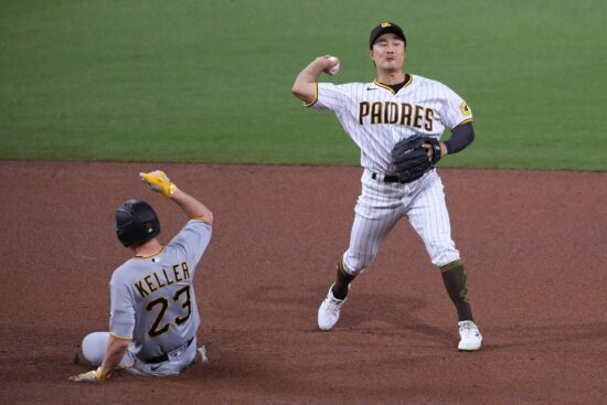 May 4, 2021; San Diego, California, USA; San Diego Padres shortstop Ha-seong Kim (R) throws to first base after forcing out Pittsburgh Pirates starting pitcher Mitch Keller (23) at second base during the sixth inning at Petco Park. Mandatory Credit: Orlando Ramirez-USA TODAY Sports