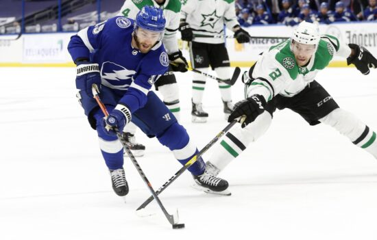 May 5, 2021; Tampa, Florida, USA; Tampa Bay Lightning right wing Barclay Goodrow (19) skates with the puck as Dallas Stars defenseman Jamie Oleksiak (2) defends during the third period at Amalie Arena. Mandatory Credit: Kim Klement-USA TODAY Sports