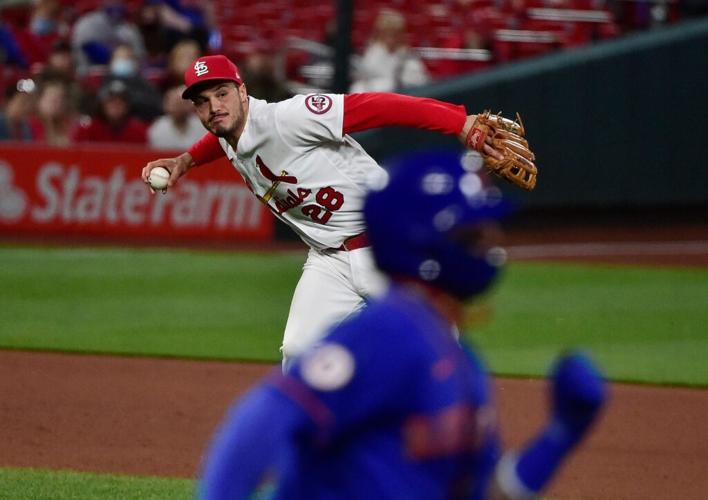 May 5, 2021; St. Louis, Missouri, USA; St. Louis Cardinals third baseman Nolan Arenado (28) throws on the run but is unable to force out New York Mets shortstop Jonathan Villar (1) during the fifth inning in game two of a doubleheader at Busch Stadium. Mandatory Credit: Jeff Curry-USA TODAY Sports