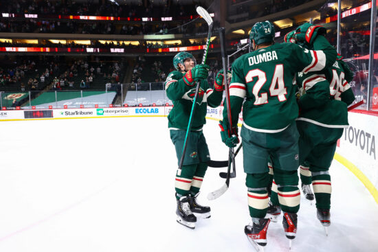 May 8, 2021; Saint Paul, Minnesota, USA; Minnesota Wild players celebrate after the game winning goal center Victor Rask (49) against the Anaheim Ducks during overtime at Xcel Energy Center. Mandatory Credit: Harrison Barden-USA TODAY Sports