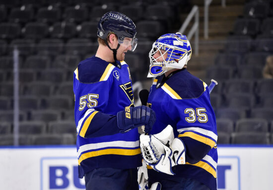 May 12, 2021; St. Louis, Missouri, USA;  St. Louis Blues goaltender Ville Husso (35) receives the game puck from defenseman Colton Parayko (55) after recording his first career shutout in a 4-0 victory over the Minnesota Wild at Enterprise Center. Mandatory Credit: Jeff Curry-USA TODAY Sports