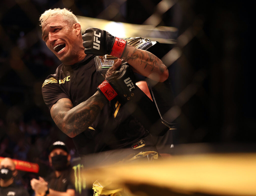 May 15, 2021; Houston, Texas, USA; Charles Oliveira reacts following his championship victory against Michael Chandler during UFC 262 at Toyota Center. Mandatory Credit: Troy Taormina-USA TODAY Sports