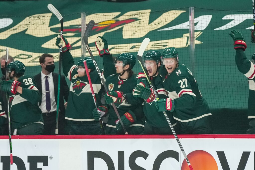 May 20, 2021; Saint Paul, Minnesota, USA; Minnesota Wild forward Kevin Fiala (22) and forward Victor Rask (49) and forward Nico Sturm (7) and forward Nick Bjugstad (27) celebrate a goal scored by forward Joel Eriksson Ek (not pictured) during the first period in game three of the first round of the 2021 Stanley Cup Playoffs against the Vegas Golden Knights at Xcel Energy Center. Mandatory Credit: Brace Hemmelgarn-USA TODAY Sports