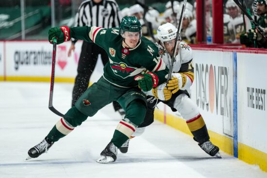 May 20, 2021; Saint Paul, Minnesota, USA; Minnesota Wild forward Joel Eriksson Ek (14) hits Vegas Golden Knights forward Chandler Stephenson (20) during the third period in game three of the first round of the 2021 Stanley Cup Playoffs at Xcel Energy Center. Mandatory Credit: Brace Hemmelgarn-USA TODAY Sports