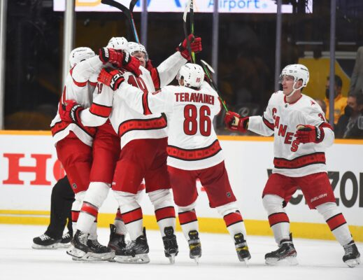 May 21, 2021; Nashville, Tennessee, USA; Carolina Hurricanes players celebrate after a game-tying goal by Carolina Hurricanes defenseman Brett Pesce (22) during the third period against the Nashville Predators in game three of the first round of the 2021 Stanley Cup Playoffs at Bridgestone Arena. Mandatory Credit: Christopher Hanewinckel-USA TODAY Sports