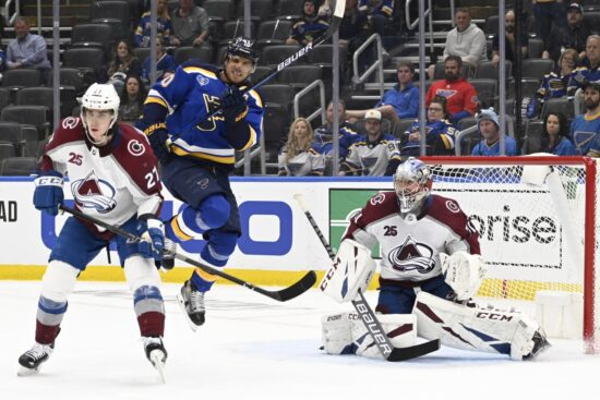May 21, 2021; St. Louis, Missouri, USA; St. Louis Blues center Brayden Schenn (10) attempts to screen Colorado Avalanche goaltender Philipp Grubauer (31) in the third period in game three of the first round of the 2021 Stanley Cup Playoffs at Enterprise Center. Mandatory Credit: Jeff Le-USA TODAY Sports
