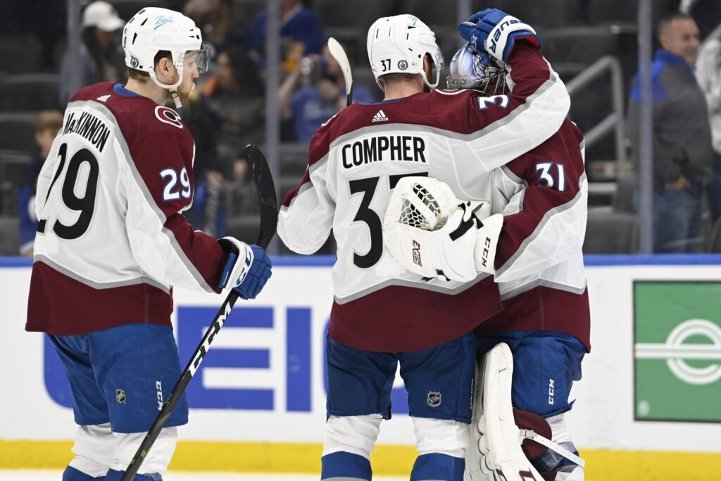 May 21, 2021; St. Louis, Missouri, USA; Colorado Avalanche center Nathan MacKinnon (29) and left wing J.T. Compher (37) congratulate goaltender Philipp Grubauer (31) after a victory over the St. Louis Blues in the third period in game three of the first round of the 2021 Stanley Cup Playoffs at Enterprise Center. Mandatory Credit: Jeff Le-USA TODAY Sports