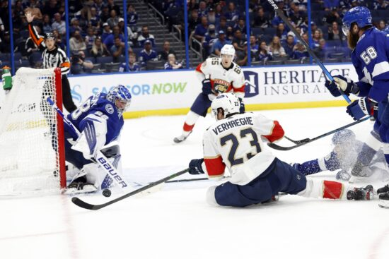 May 22, 2021; Tampa, Florida, USA; Florida Panthers center Carter Verhaeghe (23) shoots as Tampa Bay Lightning goaltender Andrei Vasilevskiy (88) defends during the second period in game four of the first round of the 2021 Stanley Cup Playoffs at Amalie Arena. Mandatory Credit: Kim Klement-USA TODAY Sports