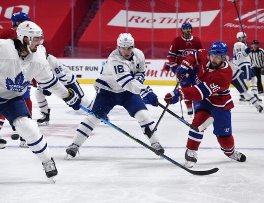 May 25, 2021; Montreal, Quebec, CAN; Montreal Canadiens forward Tomas Tatar (90) is covered by Toronto Maple Leafs defenseman Justin Holl (3) and teammate forward Mitchell Marner (16) during the second period in game four of the first round of the 2021 Stanley Cup Playoffs at Bell Centre. Mandatory Credit: Eric Bolte-USA TODAY Sports