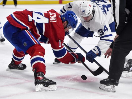 May 25, 2021; Montreal, Quebec, CAN; Montreal Canadiens forward Nick Suzuki (14) wins a face off against Toronto Maple Leafs forward Auston Matthews (34) during the third period in game four of the first round of the 2021 Stanley Cup Playoffs at Bell Centre. Mandatory Credit: Eric Bolte-USA TODAY Sports