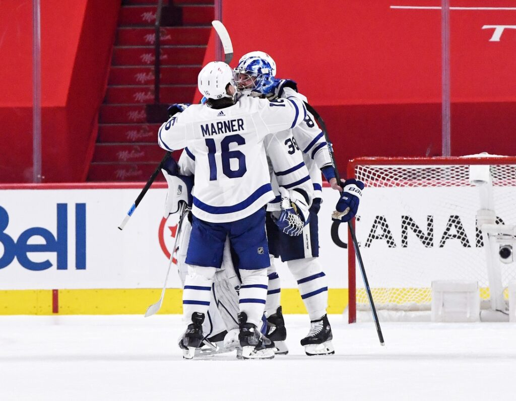 May 25, 2021; Montreal, Quebec, CAN; Toronto Maple Leafs forward Mitchell Marner (16) celebrates the shutout win against the Montreal Canadiens with teammate goalie Jack Campbell (36) during the third period in game four of the first round of the 2021 Stanley Cup Playoffs at Bell Centre. Mandatory Credit: Eric Bolte-USA TODAY Sports