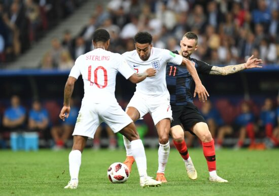 July 11, 2018; Moscow, Russia; England midfielder Jesse Lingard (7) passes the ball to midfielder Raheem Sterling (10) against the defense of Croatia midfielder Marcelo Brozovic (11) in the semifinals of the FIFA World Cup 2018 at Saint Petersburg Stadium. Mandatory Credit: Tim Groothuis/Witters Sport via USA TODAY Sports