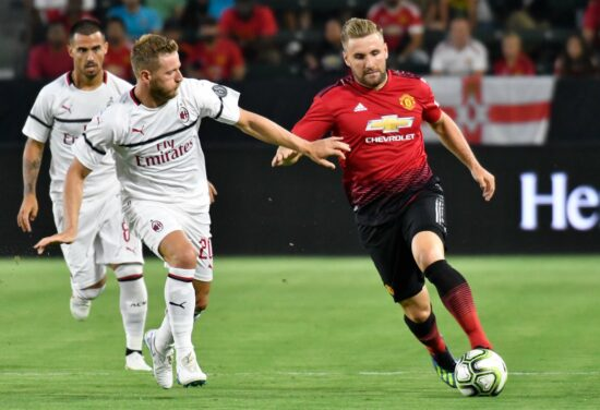 Jul 25, 2018; Carson , CA, USA; Manchester United defender Luke Shaw (23) moves the ball past Milan defender Ignazio Abate (20) in the first half during an International Champions Cup soccer match at Stubhub Center. Mandatory Credit: Robert Hanashiro-USA TODAY Sports