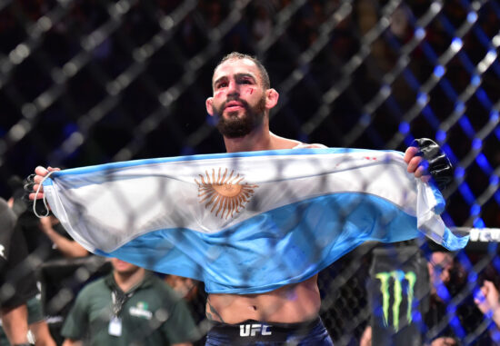 Nov 17, 2018; Buenos Aires, Argentina; Santiago Ponzinibbio (blue gloves) defeats Neil Magny (red gloves) during UFC Fight Night at Parque Roca Arena. Mandatory Credit: Jason Silva-USA TODAY Sports