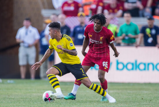 Jul 19, 2019; South Bend, IN, USA; Borussia Dortmund midfielder Jadon Sancho (7) dribbles the ball while Liverpool forward Yasser Larouci (65) defends in the first half of a preseason preparation soccer match at Notre Dame. Mandatory Credit: Trevor Ruszkowski-USA TODAY Sports