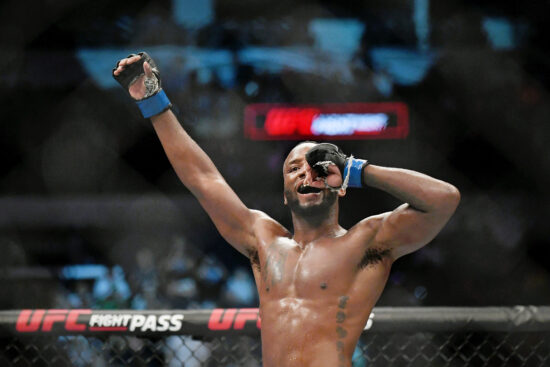 Jul 20, 2019; San Antonio, TX, USA; Leon Edwards (blue gloves) after his win over Rafael Dos Anjos (not pictured) during UFC Fight Night at AT&T Center. Edwards won by unanimous decision. Mandatory Credit: Adam Hagy-USA TODAY Sports