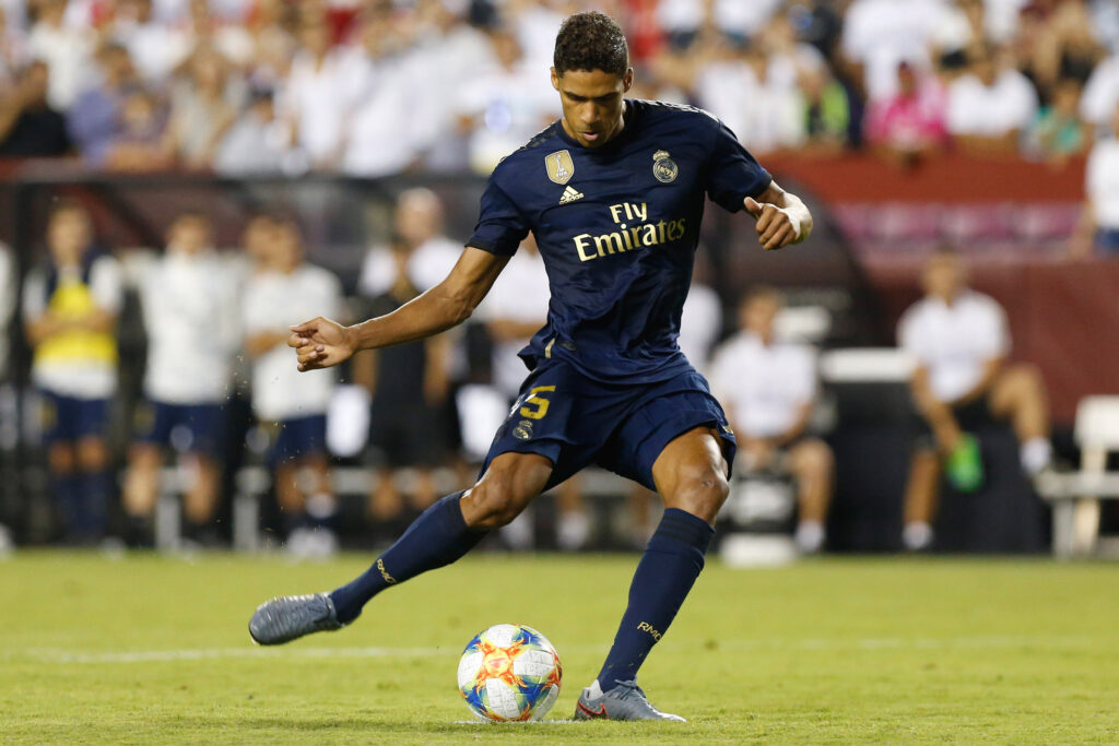 Jul 23, 2019; Landover, MD, USA; Real Madrid defender Raphael Varane (5) attempts a penalty against Arsenal in the International Champions Cup soccer series at FedEx Field. Real Madrid won 2-2 (3-2 pen.). Mandatory Credit: Geoff Burke-USA TODAY Sports
