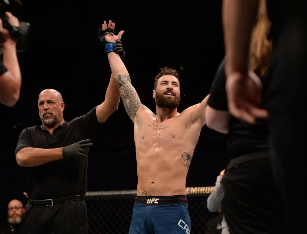 Sep 21, 2019; Mexico City, MEX; Paul Craig (blue gloves) defeats Vinicius Moreira (red gloves) during UFC Fight Night at Mexico City Arena. Mandatory Credit: Orlando Ramirez-USA TODAY Sports