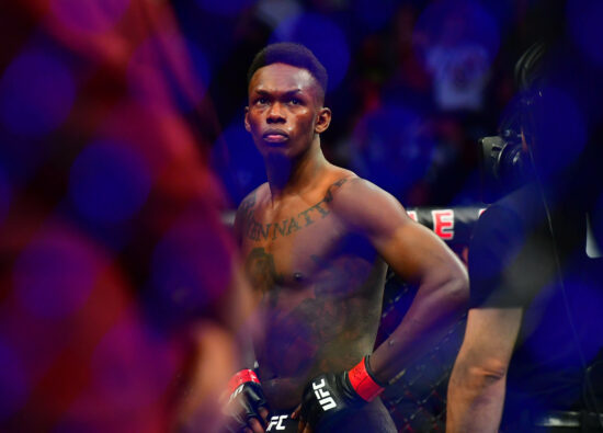 Mar 7, 2020; Las Vegas, Nevada, USA; Israel Adesanya (red gloves) before the match against Yoel Romero (blue gloves) during UFC 248 at T-Mobile Arena. Mandatory Credit: Stephen R. Sylvanie-USA TODAY Sports