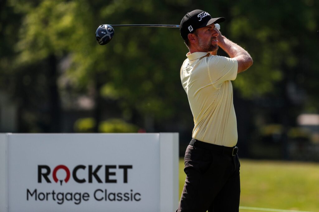 Webb Simpson tees off on No. 18 during the fourth round of the Rocket Mortgage Classic golf tournament at the Detroit Golf Club in Detroit, Sunday, July 5, 2020.