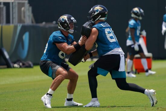 May 27, 2021; Jacksonville, Florida, USA; Jacksonville Jaguars tight end Tim Tebow (85) and tight end Ben Ellefson (86) participate in drills during OTA at the Dream Finders Homes Practice Complex. Mandatory Credit: Jasen Vinlove-USA TODAY Sports