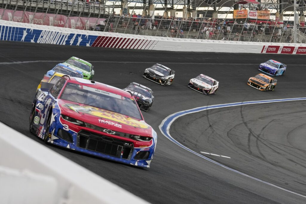 May 30, 2021; Concord, North Carolina, USA; NASCAR Cup Series driver Martin Truex Jr. (19) in a pack during the Coca-Cola 600 at Charlotte Motor Speedway. Mandatory Credit: Jim Dedmon-USA TODAY Sports