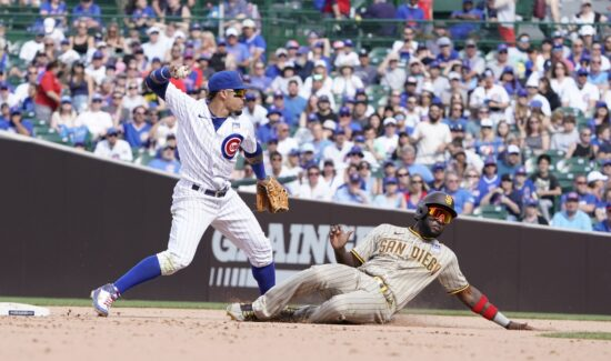 Jun 2, 2021; Chicago, Illinois, USA; Chicago Cubs shortstop Javier Baez (9) forces out San Diego Padres left fielder Jurickson Profar (10) at second base then throws to first base to complete a double play during the ninth inning at Wrigley Field. Mandatory Credit: David Banks-USA TODAY Sports