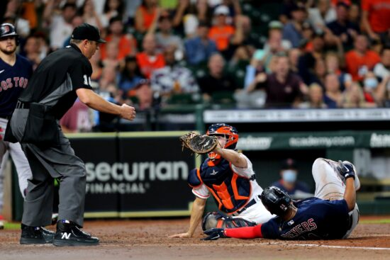 Jun 3, 2021; Houston, Texas, USA; Boston Red Sox third baseman Rafael Devers (11) is tagged out at home by Houston Astros catcher Garrett Stubbs (11) during the third inning at Minute Maid Park. Mandatory Credit: Erik Williams-USA TODAY Sports