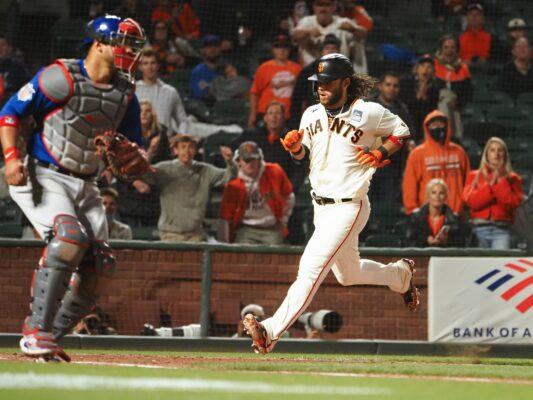 Jun 3, 2021; San Francisco, California, USA; San Francisco Giants shortstop Brandon Crawford (35) scores a run behind Chicago Cubs catcher Willson Contreras (40) during the seventh inning at Oracle Park. Mandatory Credit: Kelley L Cox-USA TODAY Sports