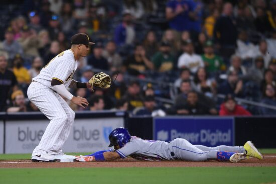 Jun 4, 2021; San Diego, California, USA; New York Mets shortstop Francisco Lindor (right) slides into third base after hitting a single and advancing on an error by San Diego Padres left fielder Tommy Pham (not pictured) during the seventh inning at Petco Park. Mandatory Credit: Orlando Ramirez-USA TODAY Sports